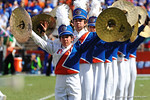 A Florida Gator band member crashes her cymbals.  Florida Gators vs Vanderbilt Commodores.  Gainesville, FL.  November 9, 2013.