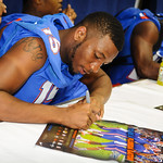 DB Loucheiz Purifoy signs a poster for a fan at the Gator Fan Day.  Stephen C. O'Connell Center.  August 17th, 2013