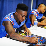 WR Alvin Bailey autographs a poster for one of the gator nation fans.  Stephen C. O'Connell Center.  August 17th, 2013.