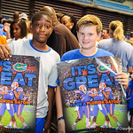 Two gator football fans wait to have their posters sign at the Gator Fan Day.  Stephen C. O'Connell Center.  August 17th, 2013