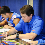 Coach Will Muschamp signs a poster during Gator Fan Day.  Stephen C. O'Connell Center.  August 17th, 2013