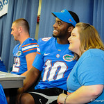 QB Tyler Murphy poses with a fan for a picture during the Gator Fan Day.  Stephen C. O'Connell Center.  August 17th, 2013