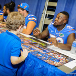 OL Tyler Moore signs a gator poster for a fan at Fan Day.  Stephen C. O'Connell Center.  August 17th, 2013.