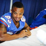 WR Solomon Patton waits to sign a poster at the Gator Fan Day.  Stephen C. O'Connell Center.  August 17th, 2013
