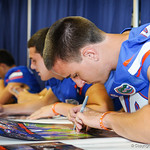 Punter Justin Vogel signs a poster during the Gator Fan Day.  Stephen C. O'Connell Center.  August 17th, 2013