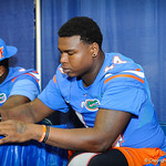 DL Leon Orr signs a poster for a fan at the Gator Fan Day.  Stephen C. O'Connell Center.  August 17th, 2013
