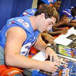 OL Trip Thurman autographs a gator poster for a fan.  Stephen C. O'Connell Center.  August 17th, 2013