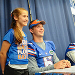 QB Jeff Driskel poses with a fan for a picture during the Gator Fan Day.  Stephen C. O'Connell Center.  August 17th, 2013