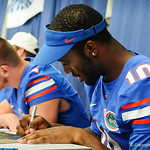 QB Tyler Murphy signs a poster for a fan at the Gator Fan Day.  Stephen C. O'Connell Center.  August 17th, 2013.