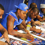 DB Marcus Roberson autographs a poster for a fan.  Stephen C. O'Connell Center.  August 17th, 2013