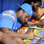 gator football players sign autographs for the fans at Gator Fan Day.  Stephen C. O'Connell Center.  August 17th, 2013