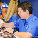 Coach Will Muschamp was all smiles as he signed posters for the fans at the Gator Fan Day.  Stephen C. O'Connell Center.  August 17th, 2013.