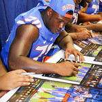 OL D.J. Humphries signing a poster for a fan at the Gator Fan Day.  Stephen C. O'Connell Center.  August 17th, 2013.