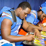 DL Damien Jacobs signing a poster during Gator Fan Day.  Stephen C. O'Connell Center.  August 17th, 2013.
