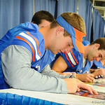 QB Jeff Driskel autographs a poster during the Gator Fan Day.  Stephen C. O'Connell Center.  August 17th, 2013