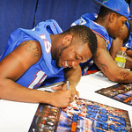 DB Loucheiz Purifoy signs a poster for a fan at the Gator Fan Day.  Stephen C. O'Connell Center.  August 17th, 2013.