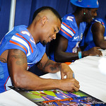 WR Solomon Patton signs a poster at the Gator Fan Day.  Stephen C. O'Connell Center.  August 17th, 2013