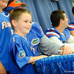 A young gator fan smiles as he poses for a picture with QB Jeff Driskel.  Stephen C. O'Connell Center.  August 17th, 2013
