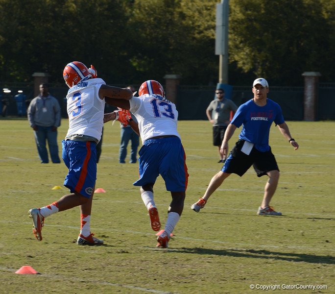 Morrison (3) and McMillian (13) lock up in punt coverage drill