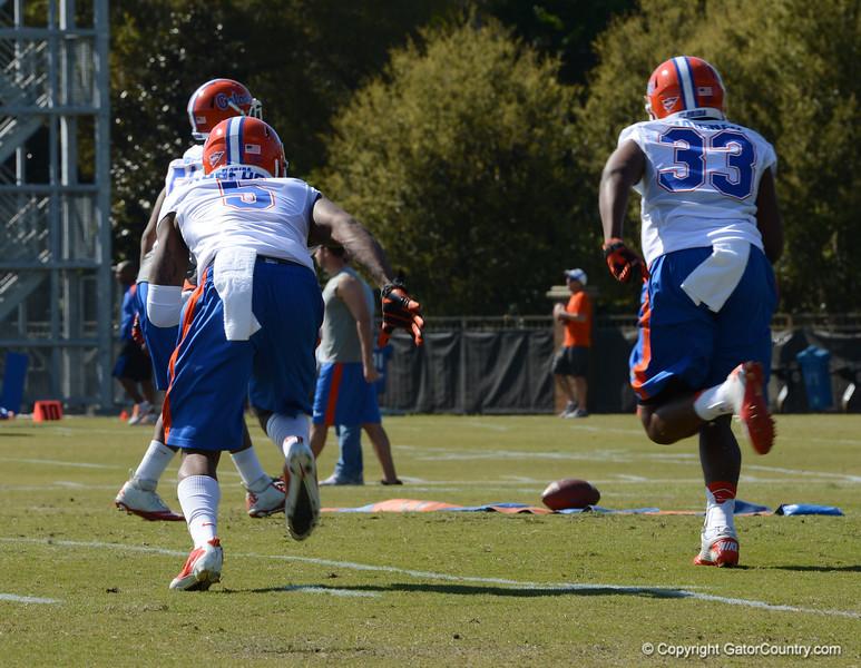Roberson (5) & Maignon (33) in D-back drills