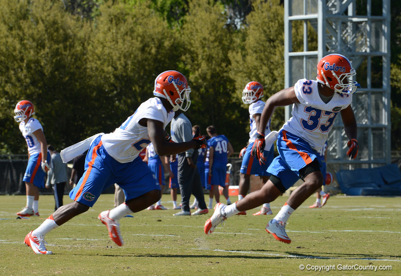 Maye (20) chases Maignon (33) during D-back coverage drills