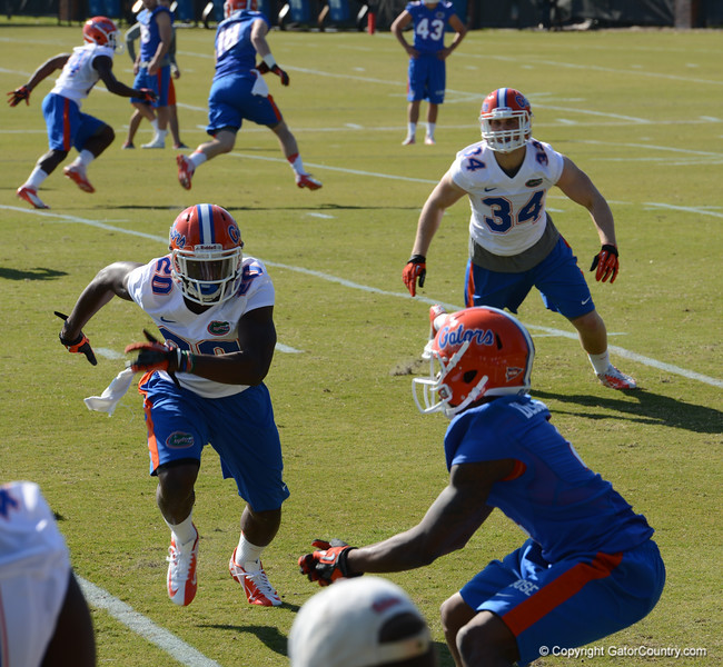 Debose (4) goes down to make the reception with Maye (20) & Anzalone (34) closing in on coverage