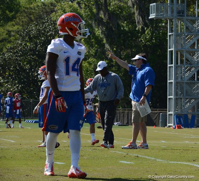 Watkins (14) prepares for D-back drills
