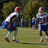 Watkins (14) participates in D-back drills against Peacock (27)