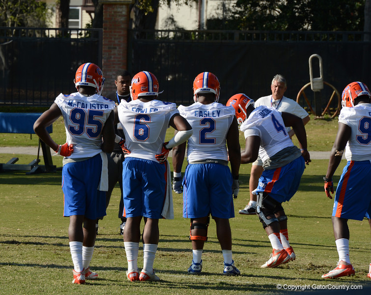 Jacobs (4) refines footwork as McCalister (95), Fowler (6) and Easley (2) look on