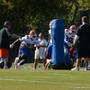 Cummings (55) and Bullard (90) practice blocking techniques