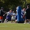 Cummings (55) and Bullard (90) practice blocking techniques
