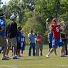 Driskel (6) passes in 11 on 11 drill with coaches Muschamp & Peace watching