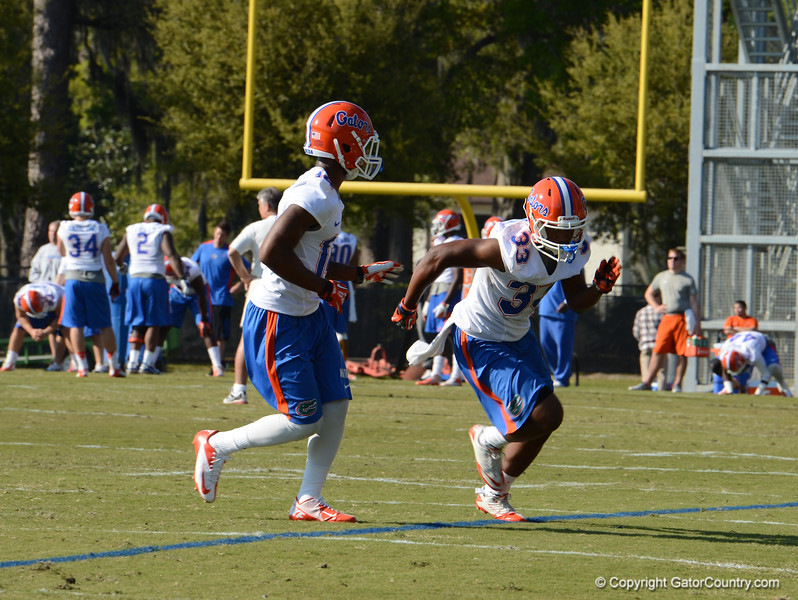 Watkins (14) in pass coverage against Maignan (33)