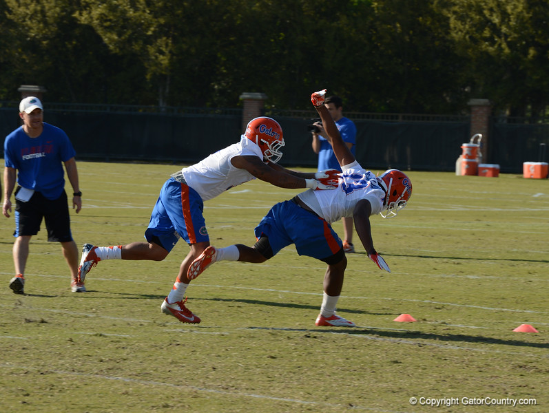 McMillian (13) draws block in the back penalty on Morrison (3) during punt coverage drill