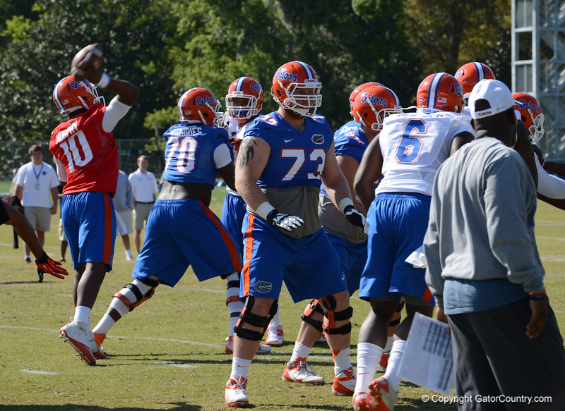 O-Line vs D-Line drills - Murphy (10) tosses pass with Fowler (6) applying on the edge against Moore (73)