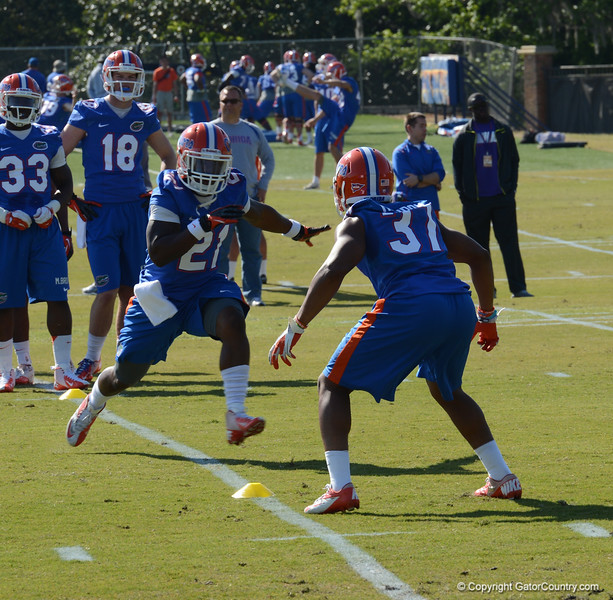 K Taylor (21) and Herndon (37) during 1 on 1 drills