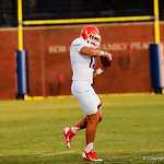 Gator football player cathes a ball during Thursday nights open gator practice.