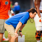 Coach Will Muschamp eyes the defense at the gators open practice on 8-15-13.