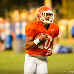 Valdez Showers runs downfield during the gators practice on 8-15-13.