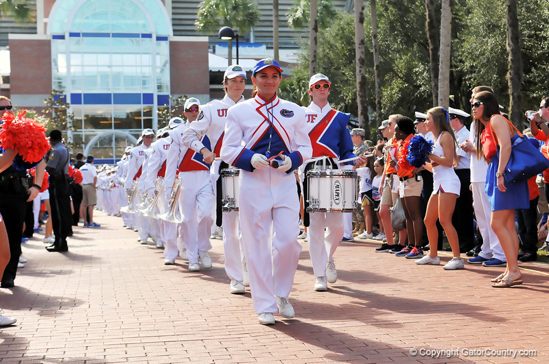 The Florida Gator band make their way down the bricks in front of Ben Hill Griffin Stadium for the start of the Gator Walk.  Florida Gators vs Georgia Southern Eagles.  Gainesville, FL.  November 23, 2013.