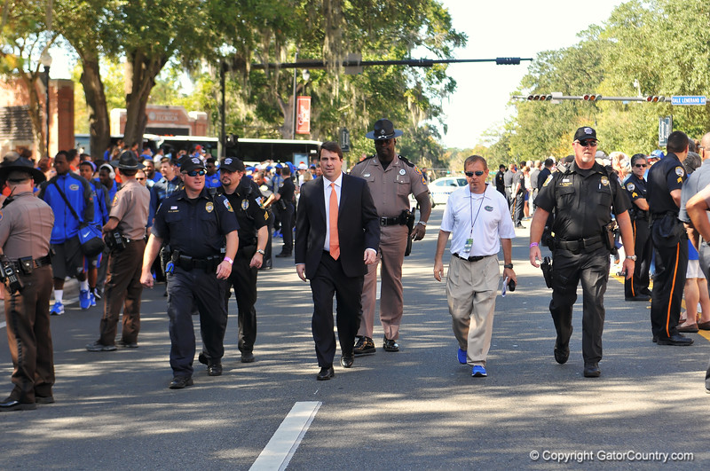 Florida Gator head coach Will Muschamp makes his way down University avenue on his way to the stadium for the game against Georgia Southern.  Florida Gators vs Georgia Southern Eagles.  Gainesville, FL.  November 23, 2013.