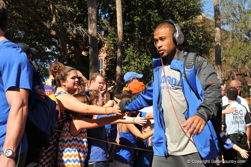 Florida Gator WR Trey Burton shakes the hands of fans as he walks into the stadium for the Georgia Southern game.  Florida Gators vs Georgia Southern Eagles.  Gainesville, FL.  November 23, 2013.