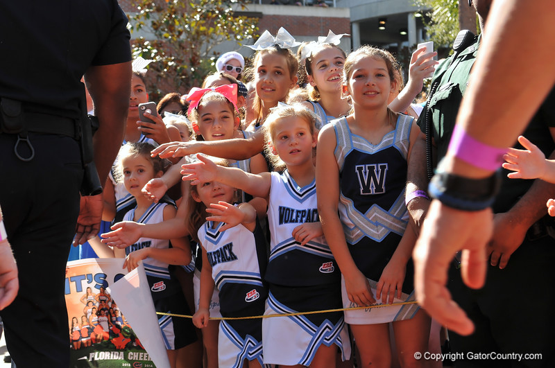A group of young cheerleaders cheer the Florida Gator football team as they walk into the stadium.  Florida Gators vs Georgia Southern Eagles.  Gainesville, FL.  November 23, 2013.