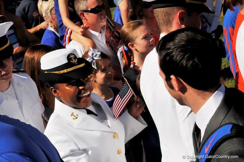 A military service woman smiles as she gets greeted by the Florida Gator football team during the Gator walk.  Florida Gators vs Georgia Southern Eagles.  Gainesville, FL.  November 23, 2013.