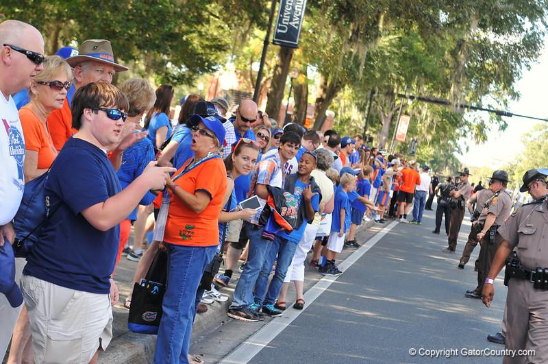 Fans line up along University avenue for the Gator walk.  Florida Gators vs Georgia Southern Eagles.  Gainesville, FL.  November 23, 2013.