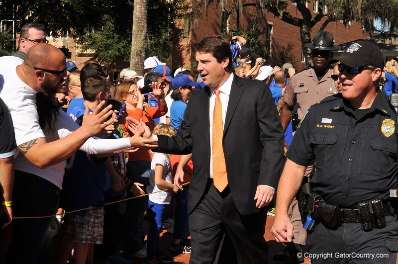 Florida Gator head coach Will Muschamp greets fans on his way into the stadium during the Gator walk.  Florida Gators vs Georgia Southern Eagles.  Gainesville, FL.  November 23, 2013.