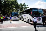 The buses arrive carrying the football team.  Gators vs Tennessee Volunteers.  September 21, 2013.