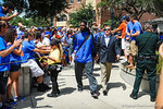 Ronald Powell and Coach Brent Pease turn the from University Ave and make their way down the bricks toward Ben Hill Griffin Stadium for the Tennessee game.  Gators vs Tennessee Volunteers.  September 21, 2013.