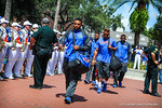 The Gator football players make their way off the bus and start their walk down University Avenue toward the stadium for the Tennessee game.  Gators vs Tennessee Volunteers.  September 21, 2013.