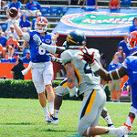 QB Jeff Driskel throws downfield.  Gators vs Toledo.  8-31-13.